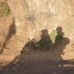 Photo of shadow of riders on motorcycle.