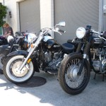 Sweet blacked out old Triumph and an Indian hiding in the background.